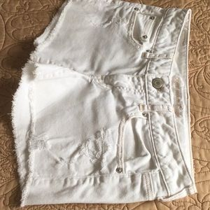 American Eagle distressed stretch short shorts.